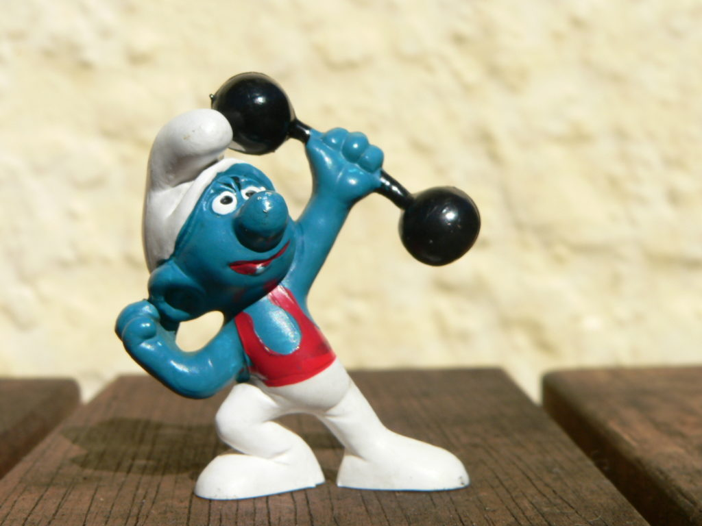 Hefty Smurf wearing a white hat and pats while heavy lifting
