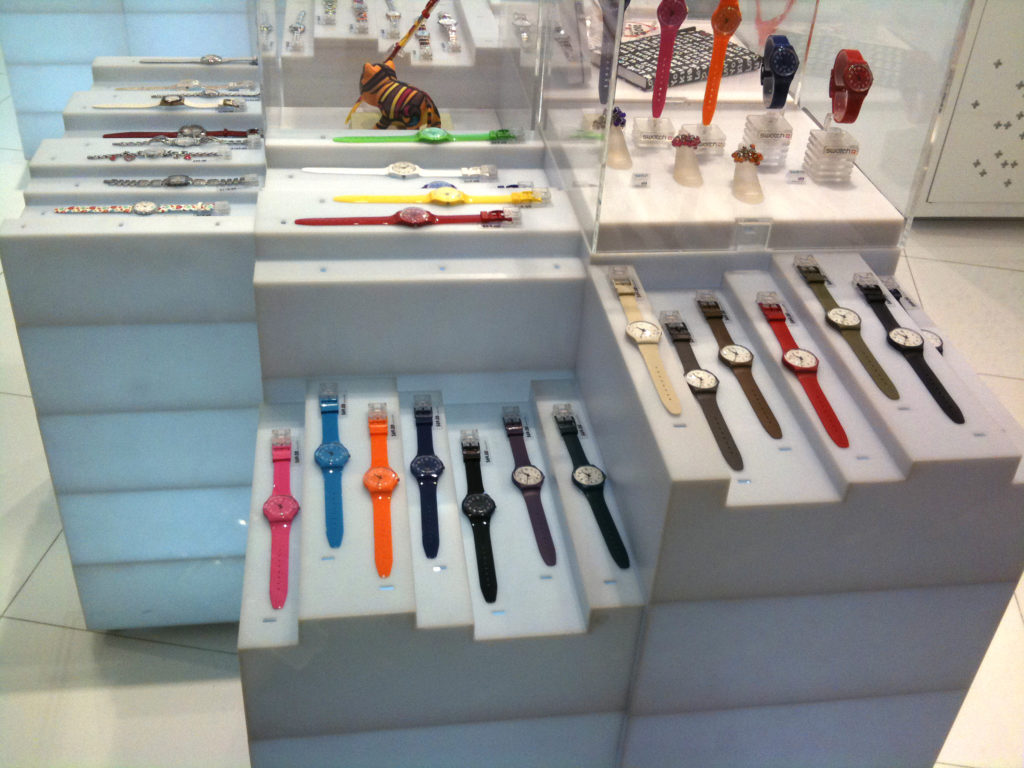 Bunch of Swatch's on display in a store