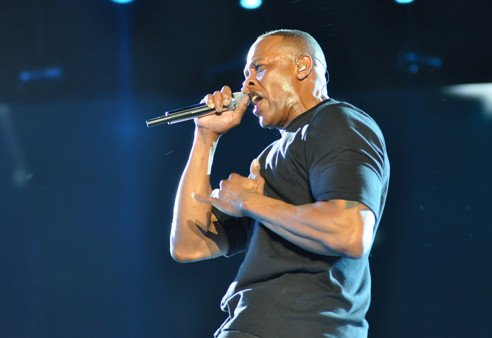 Dr. Dre holding a mic while performing on stage